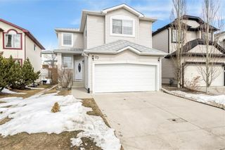 Photo 1: 23 TUSCARORA WY NW in Calgary: Tuscany House for sale : MLS®# C4174470