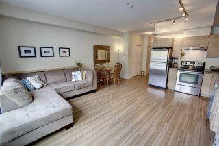 "Photo 1: 204 7445 FRONTIER Street: Pemberton Condo for sale in ""Elements"" : MLS®# R2107404"