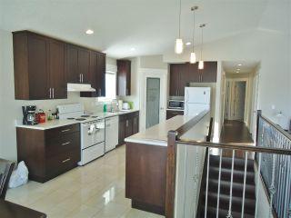 """Photo 6: 10412 109 Street in Fort St. John: Fort St. John - City NW 1/2 Duplex for sale in """"SUNSET RIDGE"""" (Fort St. John (Zone 60))  : MLS®# R2415787"""