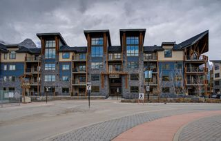 Photo 1: 410 1105 Spring Creek Drive: Canmore Apartment for sale : MLS®# A1116149