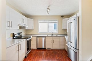 Photo 10: 99 Coverdale Way NE in Calgary: Coventry Hills Detached for sale : MLS®# A1089878