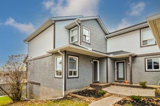 Main Photo: 404 Signal Hill Green SW in Calgary: Signal Hill Row/Townhouse for sale : MLS®# A1154899