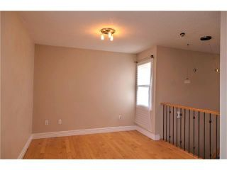 Photo 3: 248 54 GLAMIS Green SW in Calgary: Glamorgan House for sale : MLS®# C4109785