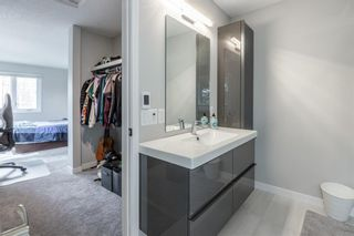 Photo 17: 24 Coachway Green SW in Calgary: Coach Hill Row/Townhouse for sale : MLS®# A1104483