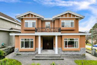 Photo 1: 1810 E 63RD Avenue in Vancouver: Fraserview VE House for sale (Vancouver East)  : MLS®# R2539366