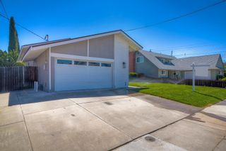 Photo 2: SAN CARLOS House for sale : 4 bedrooms : 6211 Merced Lake Ave in San Diego