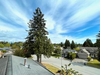 """Photo 25: 16111 10 Avenue in Surrey: King George Corridor House for sale in """"Sunnyside"""" (South Surrey White Rock)  : MLS®# R2580317"""
