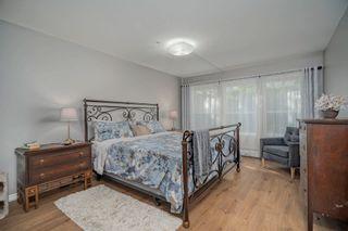 "Photo 14: 103 9650 148TH Street in Surrey: Guildford Condo for sale in ""HARTFORD WOODS"" (North Surrey)  : MLS®# R2617225"