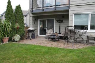 """Photo 1: 112 1466 PEMBERTON Avenue in Squamish: Downtown SQ Condo for sale in """"Marina Estates"""" : MLS®# R2114479"""