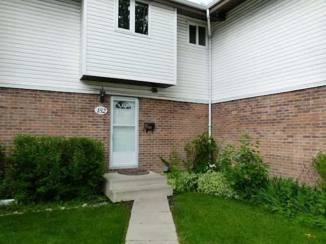 Main Photo: 152 5103 35 Avenue SW in CALGARY: Glenbrook Townhouse for sale (Calgary)  : MLS®# C3623808