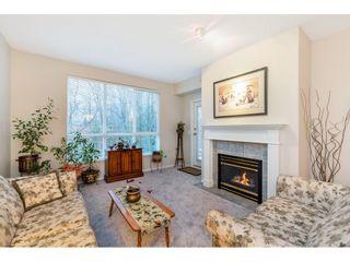 "Photo 1: 410 13860 70 Avenue in Surrey: East Newton Condo for sale in ""Chelsea Gardens"" : MLS®# R2540132"