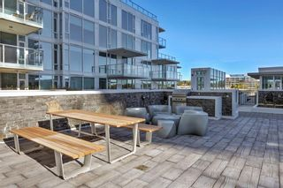 Photo 35: 113 Confluence Mews SE in Calgary: Downtown East Village Row/Townhouse for sale : MLS®# A1138938