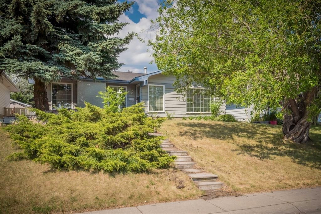 Main Photo: 12023 Candiac Road SW in Calgary: Canyon Meadows Detached for sale : MLS®# A1128675