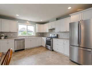 """Photo 8: 19040 60 Avenue in Surrey: Cloverdale BC House for sale in """"Cloverdale"""" (Cloverdale)  : MLS®# R2455554"""