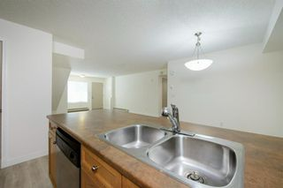 Photo 8: 124 Mckenzie Towne Lane SE in Calgary: McKenzie Towne Row/Townhouse for sale : MLS®# A1067331