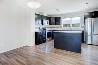 Photo 6: 64 Sunvalley Road: Cochrane Row/Townhouse for sale : MLS®# A1108247
