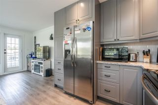 """Photo 15: 207 17740 58A Avenue in Surrey: Cloverdale BC Condo for sale in """"Derby Downs"""" (Cloverdale)  : MLS®# R2579014"""