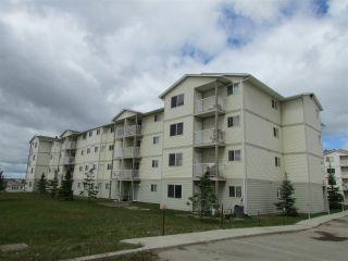 """Main Photo: 403 8507 86 Street in Fort St. John: Fort St. John - City SE Condo for sale in """"WOODSMERE"""" (Fort St. John (Zone 60))  : MLS®# R2617966"""