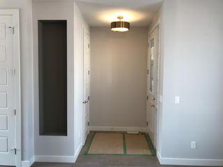 Photo 8: 23 Sunrise Heights: Cochrane Duplex for sale : MLS®# A1017998