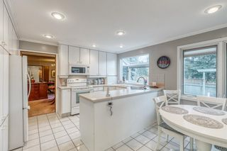 Photo 15: 244 Lake Moraine Place SE in Calgary: Lake Bonavista Detached for sale : MLS®# A1047703