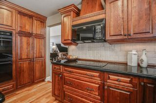 Photo 13: 74 SHAWNEE CR SW in Calgary: Shawnee Slopes House for sale : MLS®# C4226514