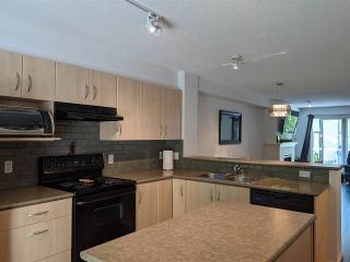 Photo 2: 102 6747 203 Street in Langley: Willoughby Heights Townhouse for sale : MLS®# R2584107