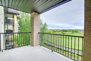 Photo 3: 7312 304 Mackenzie Way: Airdrie Apartment for sale : MLS®# A1118474