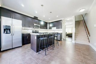 """Photo 14: 77 6383 140 Street in Surrey: Sullivan Station Townhouse for sale in """"PANORAMA WEST VILLAGE"""" : MLS®# R2573308"""