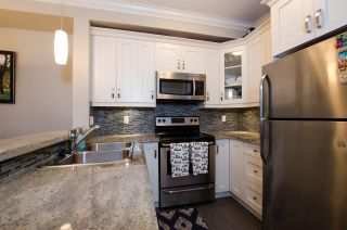 """Photo 1: 421 13897 FRASER Highway in Surrey: Whalley Condo for sale in """"EDGE"""" (North Surrey)  : MLS®# R2422441"""