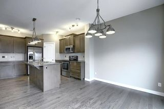 Photo 9: 40 THOROUGHBRED Boulevard: Cochrane Detached for sale : MLS®# A1027214