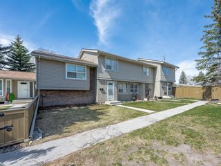 Photo 1: 55 123 Queensland Drive SE in Calgary: Queensland Row/Townhouse for sale : MLS®# A1101736