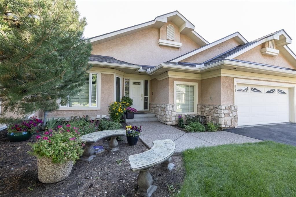 Main Photo: 159 Country Club Lane in Rural Rocky View County: Rural Rocky View MD Semi Detached for sale : MLS®# A1148360