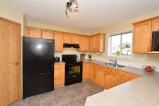 Photo 4: 41 BRIDLERIDGE Gardens SW in Calgary: Bridlewood House for sale : MLS®# C4135340