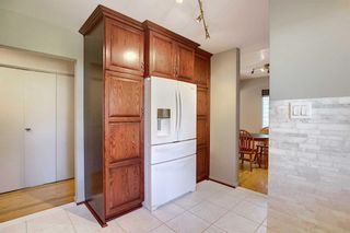 Photo 5: 2716 LOUGHEED Drive SW in Calgary: Lakeview Detached for sale : MLS®# A1032404