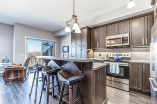 Photo 7: 603 101 SUNSET Drive: Cochrane Row/Townhouse for sale : MLS®# A1031509