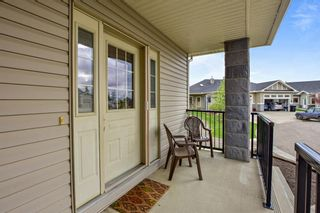 Photo 4: 45 Stromsay Gate: Carstairs Row/Townhouse for sale : MLS®# A1110468