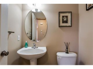 Photo 10: 1718 THORBURN Drive SE: Airdrie House for sale : MLS®# C4096360