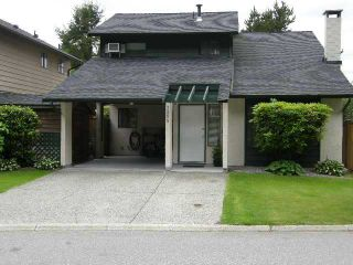 "Main Photo: 1255 BLUFF Drive in Coquitlam: River Springs House for sale in ""RIVER SPRINGS"" : MLS®# V1010046"