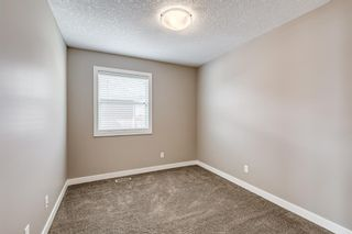 Photo 34: 410 Boulder Creek Way SE: Langdon Detached for sale : MLS®# A1128135