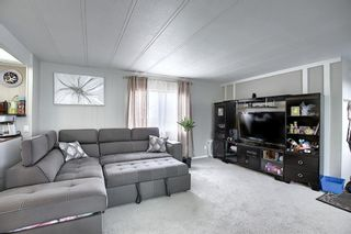Photo 7: 128 Big Springs Drive SE: Airdrie Detached for sale : MLS®# A1117897