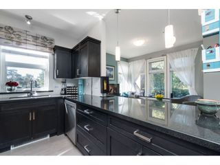 """Photo 5: 104 20062 FRASER Highway in Langley: Langley City Condo for sale in """"Varsity"""" : MLS®# R2453386"""