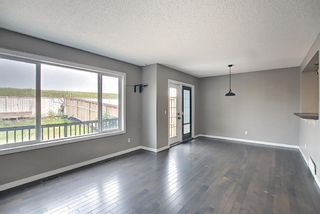 Photo 21: 566 River Heights Crescent: Cochrane Semi Detached for sale : MLS®# A1129968