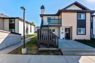 Photo 1: 91 CEDAR SPRINGS Gardens SW in Calgary: Cedarbrae Row/Townhouse for sale : MLS®# A1032381