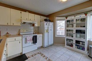 Photo 5: 307 FALTON Drive NE in Calgary: Falconridge Detached for sale : MLS®# C4238621