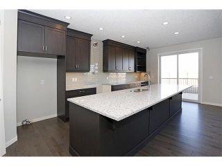 Photo 3: 141 AUBURN MEADOWS Boulevard SE in Calgary: Auburn Bay Residential Detached Single Family for sale : MLS®# C3637003