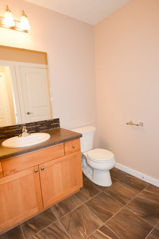 Photo 8: 8720 76 Street in Fort St. John: 1/2 Duplex for sale