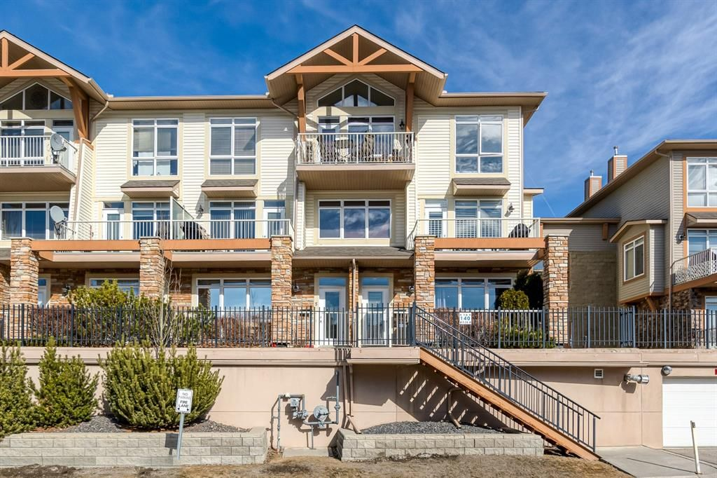 Main Photo: 6 140 ROCKYLEDGE View NW in Calgary: Rocky Ridge Row/Townhouse for sale : MLS®# A1079853