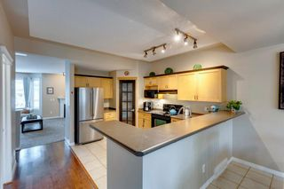 Photo 7: 90 Country Hills Gardens NW in Calgary: Country Hills Row/Townhouse for sale : MLS®# A1118931