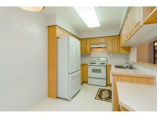 "Photo 8: 322 13880 70 Avenue in Surrey: East Newton Condo for sale in ""Chelsea Gardens"" : MLS®# R2348345"