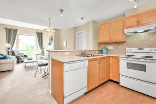 "Photo 3: 405 15188 22 Avenue in Surrey: Sunnyside Park Surrey Condo for sale in ""Muirfield Gardens"" (South Surrey White Rock)  : MLS®# R2600390"